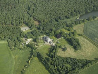 Oblique aerial view centred on the country house, dovecot, and remains of the chapel, taken from the NW.