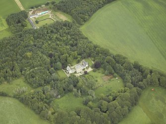 Oblique aerial view centred on the country house with the farmhouse, farmsteading and granary adjacent, taken from the WSW.