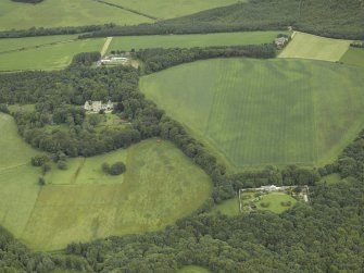 General oblique aerial view centred on the country house with the farmhouse, farmsteading and granary in the distance and the walled garden and cottage in the foreground, taken from the S.