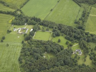 General oblique aerial view centred on the castle and walled garden with the farmhouse and farmsteading adjacent, taken from the W.