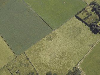 Oblique aerial view centred on the remains of the recumbent stone circle, taken from the NW.