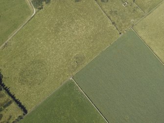 Oblique aerial view centred on the remains of the recumbent stone circle, taken from the SE.