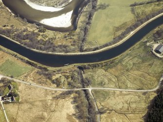 Oblique aerial view centred on the canal, aqueduct and road bridge, taken from the NW.