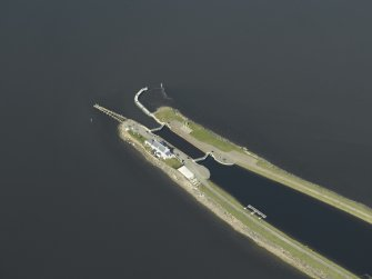 Oblique aerial view centred on the lock, house, piers and beacons at Clachnaharry, Caledonian Canal, Inverness, taken from the SSE.