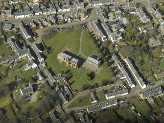 Oblique aerial view centred on the cathedral and the chapel, taken from the SE.