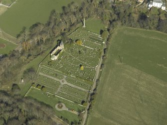 Oblique aerial view centred on the chapel, burial-ground and monument, taken from the SW.