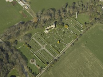 Oblique aerial view centred on the chapel, burial-ground and monument, taken from the SSW.