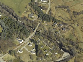 Oblique aerial view centred on the road bridges, taken from the SW.