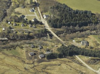 Oblique aerial view centred on the road bridges, taken from the E.