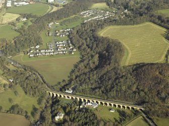 Oblique aerial view centred on Newbattle Railway Viaduct with King's Gate housing estate in the background, taken from the S.
