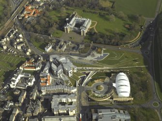 Oblique aerial view centred on Holyrood Palace, Abbey, new Parliament building and 'Our Dynamic Earth', taken from the WSW.