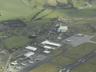 Oblique aerial view centred on the former RAF base at Turnhouse, taken from the WNW.