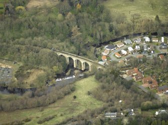 Oblique aerial view centred on the railway viaduct, taken from the SW.