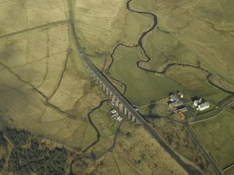 Oblique aerial view centred on viaduct and Shankend Farm, taken from the S.