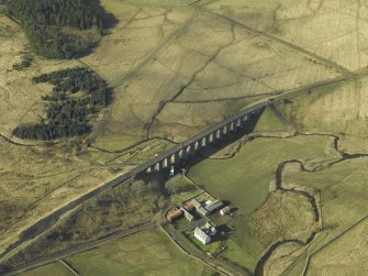 Oblique aerial view centred on viaduct and Shankend Farm, taken from the E.