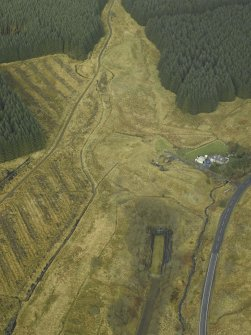 Oblique aerial view centred on S end of Whitrope railway tunnel  and Whitrope Cottages, taken from the SW.