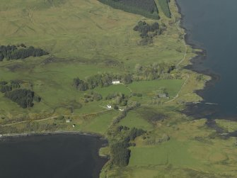General oblique aerial view centred on the house, church, cemetery and farmstead, taken from the SW.