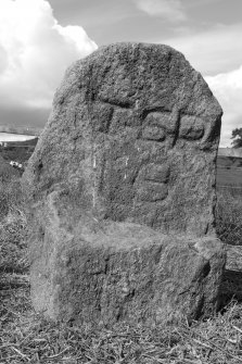 Upper Manbean Pictish symbol stone. View of reverse showing carved initials (B&W)