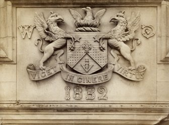 Detail of Davidson Arms dated 1832, with text; 'Davidson Arms  Carved in stone over the principal door at Muirhouse'.
