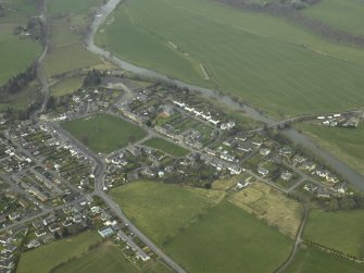 Oblique aerial view centred on village and the Teviot Bridge, taken from the E.