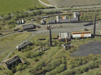 Oblique aerial view of the remains of the ironworks, taken from the NE.