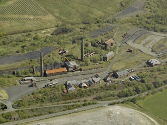 Oblique aerial view of the remains of the ironworks, taken from the WSW.