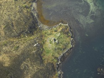 Oblique aerial view centred on the remains of the towerhouse, taken from the E.