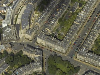 Oblique aerial view centred on St Vincent Street with St Stephen's Church adjacent, taken from the SW.