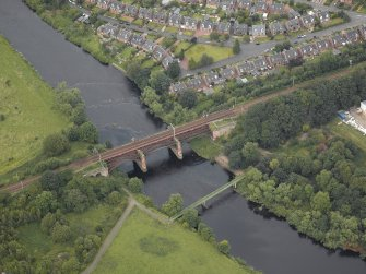 Oblique aerial view centred on the New Clyde railway viaduct, Uddingston, taken from the SSW.