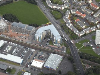 Oblique aerial view centred on Drybrough Crescent showing second phase of new housing development under construction, taken from the WNW.