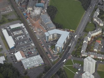 Oblique aerial view centred on Drybrough Crescent showing second phase of new housing development under construction, taken from the WSW.