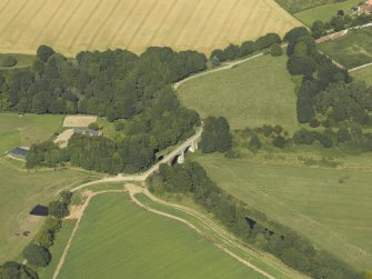 Oblique aerial view centred on the viaduct and bridge with the walled garden adjacent, taken from the S.