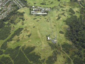 Oblique aerial view centred on the remains of Blackford Hill fort with the observatory in the background, taken from the W.