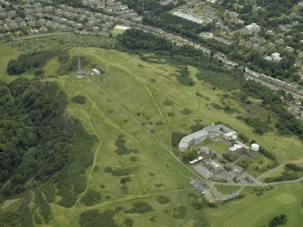 Oblique aerial view centred on the observatory with the remains of the fort in the background, taken from the SE.