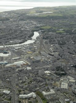General oblique aerial view of the city centre centred on Guild Street station, taken from the N.