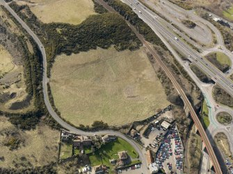 Oblique aerial view centered on the former golf course with the railway viaduct adjacent, taken from the N.
