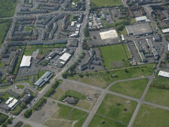 General oblique aerial view centred on St Francis' School with the Castlebrae Housing Estate adjacent, taken from the E..