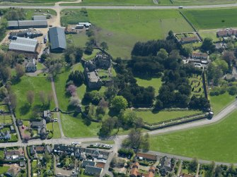 Oblique aerial view centred on the castle with the garden adjacent, taken from the N.