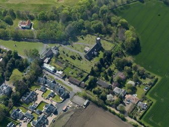 Oblique aerial view centred on the parish church with the church hall adjacent, taken from the NE.