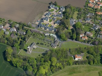 Oblique aerial view centred on the parish church with the church hall adjacent, taken from the WSW.
