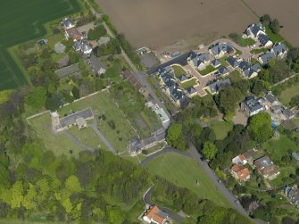 Oblique aerial view centred on the parish church with the church hall adjacent, taken from the SW.
