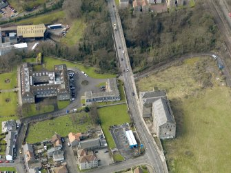 Oblique aerial view centred on Nairn's south factory with the office block adjacent, taken from the NE.