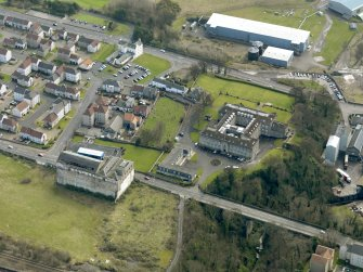 Oblique aerial view centred on Nairn's south factory with the office block adjacent, taken from the NW.