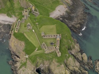 Oblique aerial view centred on Dunnottar Castle, taken from the E.