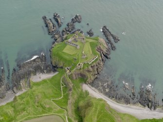 Oblique aerial view centred on Dunnottar castle, taken from the WSW.