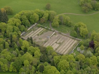 Oblique aerial view centred on the walled garden, taken from the SW.