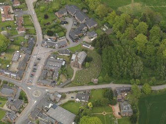 Oblique aerial view centred on the village centre, taken from the S.