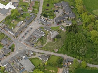 Oblique aerial view centred on the village centre, taken from the SE.