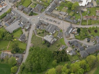 Oblique aerial view centred on the village centre, taken from the NE.