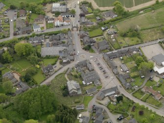 Oblique aerial view centred on the village centre, taken from the NNE.